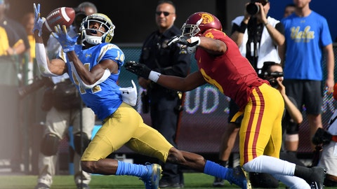 Nov 17, 2018; Pasadena, CA, USA; UCLA Bruins wide receiver Theo Howard (14) makes a catch for a touchdown against USC Trojans wide receiver Amon-Ra St. Brown (8)during the first half at Rose Bowl. Mandatory Credit: Richard Mackson-USA TODAY Sports