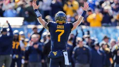 Nov 10, 2018; Morgantown, WV, USA; West Virginia Mountaineers quarterback Will Grier (7) celebrates after a touchdown during the second quarter against the TCU Horned Frogs at Mountaineer Field at Milan Puskar Stadium. Mandatory Credit: Ben Queen-USA TODAY Sports