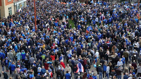 <p>               Leicester City fans gather at Jubilee Square in Leicester, before taking part in a memorial walk to the King Power Stadium, in honour of the club's owner Vichai Srivaddhanaprabha and four others who died in a helicopter crash outside the stadium on October 27.  Saturday Nov. 10, 2018. (Aaron Chown/PA via AP)             </p>
