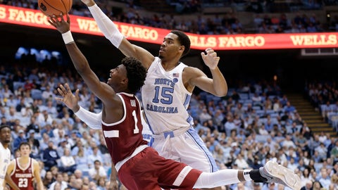 <p>               North Carolina's Garrison Brooks (15) defends while Stanford's Daejon Davis (1) drives to the basket during the second half of an NCAA college basketball game in Chapel Hill, N.C., Monday, Nov. 12, 2018. North Carolina won 90-72. (AP Photo/Gerry Broome)             </p>