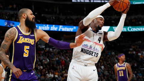 <p>               Denver Nuggets forward Paul Millsap, right, pulls in a rebound as Los Angeles Lakers center Tyson Chandler defends during the second half of an NBA basketball game Tuesday, Nov. 27, 2018, in Denver. The Nuggets won 117-85. (AP Photo/David Zalubowski)             </p>