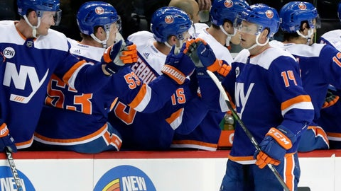 <p>               New York Islanders' Tom Kuhnhackl (14) celebrates a goal with teammates during the first period of an NHL hockey game against the Vancouver Canucks Tuesday, Nov. 13, 2018, in New York. (AP Photo/Frank Franklin II)             </p>