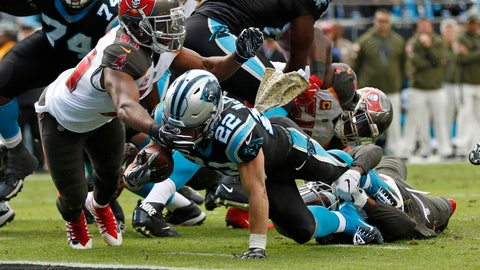 <p>               Carolina Panthers' Christian McCaffrey (22) runs for a touchdown as Tampa Bay Buccaneers' Adarius Taylor (53) defends in the first half of an NFL football game in Charlotte, N.C., Sunday, Nov. 4, 2018. (AP Photo/Nell Redmond)             </p>