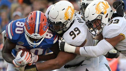 <p>               Florida tight end C'yontai Lewis (80) is stopped for a loss by Missouri defensive linemen Walter Palmore (99) and Chris Turner (39) after catching a pass during the second half of an NCAA college football game Saturday, Nov. 3, 2018, in Gainesville, Fla. (AP Photo/Phelan M. Ebenhack)             </p>