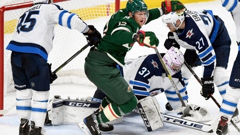 <p>               Minnesota Wild's Eric Staal (12) celebrates a goal as Winnipeg Jets' Mathieu Perreault (85), goaltender Connor Hellebuyck (37) and Ehlers (27), of Denmark, watch during the third period of an NHL hockey game Friday, Nov. 23, 2018, in St. Paul, Minn. The Wild won 4-2. (AP Photo/Hannah Foslien)             </p>