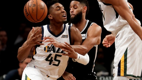 <p>               Utah Jazz guard Donovan Mitchell, left, loses the ball while driving against Brooklyn Nets guard Allen Crabbe during the first half of an NBA basketball game, Wednesday, Nov. 28, 2018, in New York. (AP Photo/Julio Cortez)             </p>