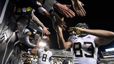 <p>               Georgia Tech wide receiver Brad Stewart (83) and quarterback Tobias Oliver (8) celebrate with fans after an NCAA college football game against Miami on Saturday, Nov. 10, 2018, in Atlanta. Georgia Tech won 27-21. (AP Photo/John Amis)             </p>