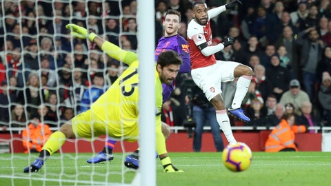 <p>               Arsenal's Alexandre Lacazette, right, attempts a shot at goal during the English Premier League soccer match between Arsenal and Liverpool at Emirates stadium in London, England, Saturday, Nov. 3, 2018. (AP Photo/Tim Ireland)             </p>