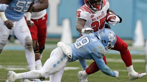 <p>               North Carolina State's Reggie Gallaspy II (25) runs while North Carolina's Corey Bell Jr. (18) tackles during the first half of an NCAA college football game in Chapel Hill, N.C., Saturday, Nov. 24, 2018. (AP Photo/Gerry Broome)             </p>