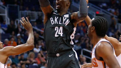 <p>               Brooklyn Nets forward Rondae Hollis-Jefferson (24) drives between the Phoenix Suns defense during the first half of an NBA basketball game Tuesday, Nov. 6, 2018, in Phoenix. (AP Photo/Rick Scuteri)             </p>