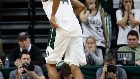 <p>               Michigan State forward Nick Ward (44) hobbles off the court during the first half of the team's NCAA college basketball game against Louisiana-Monroe, Wednesday, Nov. 14, 2018, in East Lansing, Mich. Ward went down midway through the first half and pounded the court with both fists. The forward got up and hobbled off the court, trying to keep weight off his right leg. (AP Photo/Carlos Osorio)             </p>