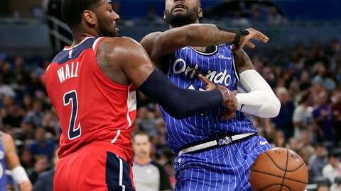 <p>               Orlando Magic's Jonathon Simmons, right, loses control of the ball as he goes to the basket against Washington Wizards' John Wall (2) during the second half of an NBA basketball game, Friday, Nov. 9, 2018, in Orlando, Fla. (AP Photo/John Raoux)             </p>