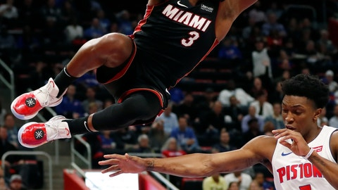 <p>               Detroit Pistons forward Stanley Johnson (7) reaches for the ball after a dunk by Miami Heat guard Dwyane Wade during the second half of an NBA basketball game, Monday, Nov. 5, 2018, in Detroit. (AP Photo/Carlos Osorio)             </p>