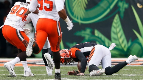 <p>               Cincinnati Bengals quarterback Andy Dalton, right, fails to recover a fumble in the second half of an NFL football game against the Cleveland Browns, Sunday, Nov. 25, 2018, in Cincinnati. (AP Photo/Gary Landers)             </p>