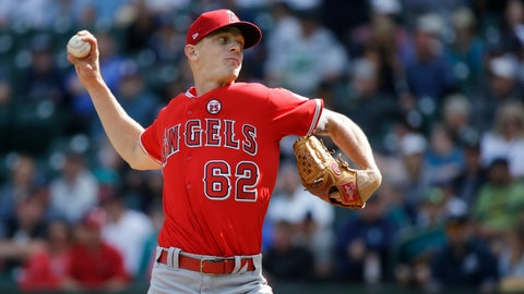 <p>               FILE - In this Sept. 10, 2017, file photo, Los Angeles Angels starting pitcher Parker Bridwell throws in the first inning of a baseball game against the Seattle Mariners in Seattle. Bridwell was claimed off waivers from the Angels by the New York Yankees on Monday, Nov. 26, 2018, who opened a roster spot by designating infielder Ronald Torreyes for assignment. (AP Photo/Ted S. Warren, File)             </p>
