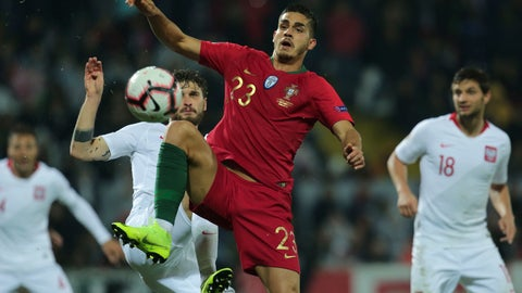 <p>               Portugal's Andre Silva vies for the ball with Poland's Mateusz Klich, center left, during the UEFA Nations League soccer match between Portugal and Poland at the D. Afonso Henriques stadium in Guimaraes, Portugal, Tuesday, Nov. 20, 2018. (AP Photo/Manuel Araujo)             </p>