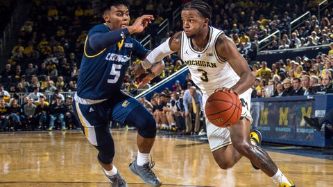 <p>               Chattanooga guard Donovann Toatley (5) defends against Michigan guard Zavier Simpson (3) in the first half of an NCAA college basketball game at Crisler Center in Ann Arbor, Mich., Friday, Nov. 23, 2018. (AP Photo/Tony Ding)             </p>