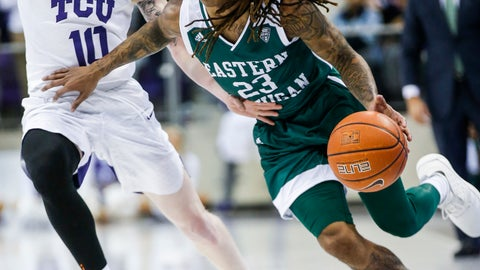 <p>               Eastern Michigan guard Damari Parris (23) battles TCU guard Jaylen Fisher (10) for space during the first half of an NCAA college basketball game Monday, Nov. 26, 2018, in Fort Worth, Texas. (AP Photo/Brandon Wade)             </p>