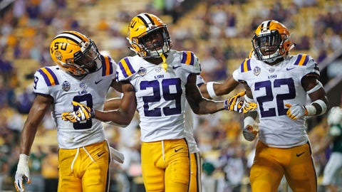 <p>               FILE - In this Sept. 8, 2018, file photo, LSU cornerback Greedy Williams (29) celebrates his interception with safety Grant Delpit (9) and cornerback Kristian Fulton (22) in the second half of an NCAA college football game against Southeastern Louisiana in Baton Rouge, La. LSU leads the nation with 14 interceptions.  (AP Photo/Gerald Herbert, File)             </p>
