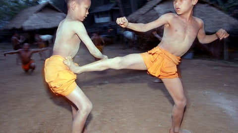 <p>               FILE - In this March 19, 2002, file photo, two novice Buddhist monks practice Muay Thai (Thai kickboxing) during a morning training session at the Golden Horse Monastery in northern Thailand. The death of a 13-year-old boy who was knocked out during a Muay Thai boxing match in Thailand has sparked debate over whether to ban child boxing. (AP Photo/David Longstreath, File)             </p>