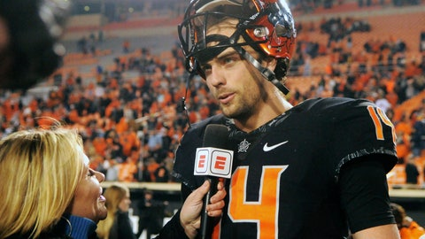 <p>               Oklahoma State quarterback Taylor Cornelius speaks with a reporter following an NCAA college football game in Stillwater, Okla., Saturday, Nov. 17, 2018. Oklahoma State defeated West Virginia 45-41. (AP Photo/Brody Schmidt)             </p>