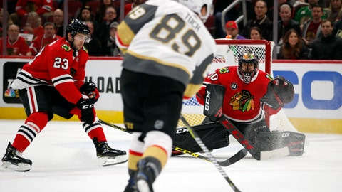 <p>               Vegas Golden Knights right wing Alex Tuch (89) shoots the puck past Chicago Blackhawks goaltender Corey Crawford (50) and Brandon Manning (23) to score a goal during the first period of an NHL hockey game Tuesday, Nov. 27, 2018, in Chicago. (AP Photo/Jeff Haynes)             </p>