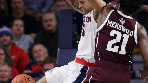 <p>               Gonzaga forward Brandon Clarke, left, dunks while defended by Texas A&M forward Christian Mekowulu (21) during the first half of an NCAA college basketball game in Spokane, Wash., Thursday, Nov. 15, 2018. (AP Photo/Young Kwak)             </p>