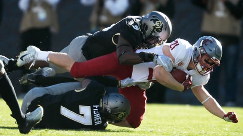 <p>               Washington State running back Max Borghi, center, is tackled after a short gain by Colorado linebacker Davion Taylor, top, and defensive back Nick Fisher in the first half of an NCAA college football game Saturday, Nov. 10, 2018, in Boulder, Colo. (AP Photo/David Zalubowski)             </p>