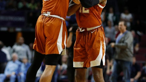 <p>               Texas' Kerwin Roach II, right, and Elijah Mitrou-Long (55) celebrate after Texas defeated North Carolina 92-89 in an NCAA college basketball game Thursday, Nov. 22, 2018, in Las Vegas. (AP Photo/John Locher)             </p>