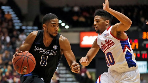 <p>               Buffalo's CJ Massinburg (5) heads to the basket past Southern Illinois' Aaron Cook during the first half of an NCAA college basketball game Monday, Nov. 12, 2018, in Carbondale, Ill. (AP Photo/Jeff Roberson)             </p>