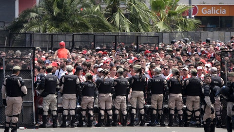 <p>               Security forces stand guard outside outside Antonio Vespucio Liberti stadium where River Plate soccer fans  gather before the announcement that their team's final Copa Libertadores match against rival Boca Juniors is suspended for a second day in a row in Buenos Aires, Argentina, Sunday, Nov. 25, 2018. In one of the most embarrassing weekends in South American football history, the Copa Libertadores final was once more postponed on Sunday. The same decision was made on Saturday after Boca's bus was attacked by River fans.  (AP Photo/Diego Martinez)             </p>