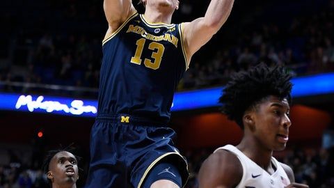 <p>               Michigan's Ignas Brazdeikis (13) goes up to the basket between Providence's Jimmy Nichols Jr. (5) and David Duke (3) during the first half of an NCAA college basketball game, Sunday, Nov. 18, 2018, in Uncasville, Conn. (AP Photo/Jessica Hill)             </p>