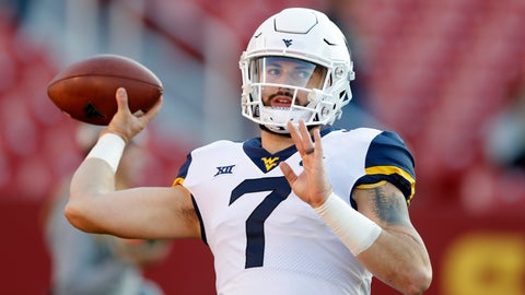 <p>               FILE - In this Saturday, Oct. 13, 2018 file photo, West Virginia quarterback Will Grier warms up before an NCAA college football game against Iowa State in Ames, Iowa. No. 6 West Virginia and No. 12 Oklahoma meet Friday night in Morgantown, W.Va., with the winner earning a berth in the Big 12 championship game next week. (AP Photo/Charlie Neibergall, File)             </p>