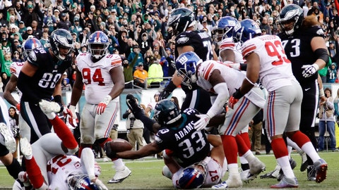 <p>               Philadelphia Eagles' Josh Adams (33) scores a two-point conversion during the second half of an NFL football game against the New York Giants, Sunday, Nov. 25, 2018, in Philadelphia. (AP Photo/Michael Perez)             </p>