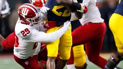 <p>               Michigan running back Karan Higdon (22) runs as Indiana defensive back Khalil Bryant (29) makes the tackle in the first half of an NCAA college football game in Ann Arbor, Mich., Saturday, Nov. 17, 2018. (AP Photo/Paul Sancya)             </p>