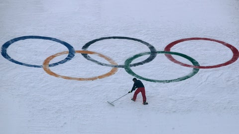 """<p>               FILE - In this Feb. 10, 2018, file photo, a worker grooms the snow after installing a set of Olympic Rings on the ski jump hill at the 2018 Winter Olympics at the Alpensia Ski Jumping Center in Pyeongchang, South Korea. Does anyone really want to host the Winter Olympics? Residents in Calgary answered that question with a resounding """"No,"""" and now the International Olympic Committee has some soul-searching to do. (AP Photo/Charlie Riedel, File)             </p>"""