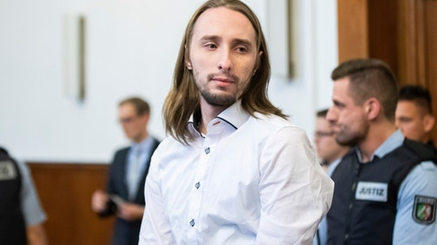 <p>               Defendant Sergej W. arrives at the Assize Court in Dortmund, Germany, Nov. 27, 2018. The court has convicted W. on 28 counts of attempted murder in last year's attack on the Borussia Dortmund soccer team's bus. The dpa news agency reported that the defendant, who has been identified only as Sergej W. in line with German privacy rules, was sentenced to 14 years in prison by the Dortmund state court on Tuesday. (Marcel Kusch/dpa via AP)             </p>