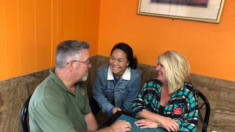 <p>               In this Nov. 8, 2018, photo Haven Shepherd, center, visits with her parents, Rob and Shelly Shepherd, in Sarcoxie, Mo. When Haven was 14 months old, she lost her legs when her birth parents strapped bombs to themselves and placed her in between them. The parents died. Haven was adopted by Rob and Shelly and is now an elite swimmer, attempting to make the U.S. Paralympic team for 2020. (AP Photo/Eddie Pells)             </p>