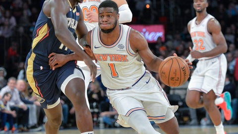 <p>               New York Knicks guard Emmanuel Mudiay (1) on the fast break with New Orleans Pelicans guard Jrue Holiday (11) in the third quarter of an NBA basketball game, Friday, Nov. 23, 2018, in New York. (AP Photo/Howard Simmons)             </p>