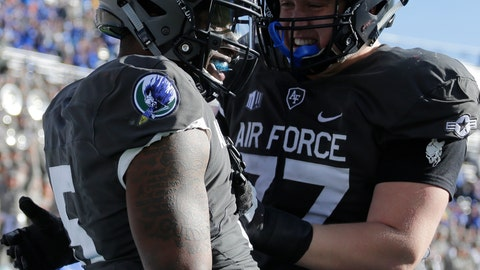 <p>               Air Force quarterback Donald Hammond III (5) celebrates a touchdown run with teammate Taven Birdow (33) during the first half of an NCAA college football game against New Mexico, Saturday, Nov. 10, 2018, at Air Force Academy, Colo. (AP Photo/Jack Dempsey)             </p>