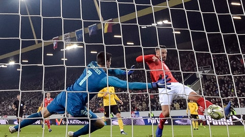 <p>               Switzerland's Haris Seferovic, right, scores past Belgium's goalkeeper Thibaut Courtois during the UEFA Nations League soccer match between Switzerland and Belgium at the swissporarena stadium in Lucerne, Switzerland, on Sunday, Nov. 18, 2018. (Peter Schneider/Keystone via AP)             </p>