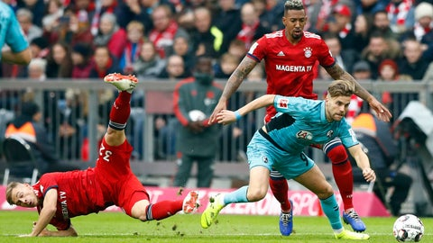 <p>               Bayern's Joshua Kimmich, left, Bayern's Jerome Boateng, background right, and Freiburg's Lucas Hoeler challenge for the ball during the German Bundesliga soccer match between FC Bayern Munich and SC Freiburg in Munich, Germany, Saturday, Nov. 3, 2018. (AP Photo/Matthias Schrader)             </p>