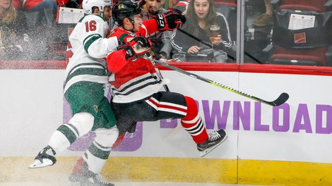 <p>               Minnesota Wild left wing Jason Zucker, left, battles for the puck with Chicago Blackhawks defenseman Gustav Forsling, right, during the second period of an NHL hockey game Sunday, Nov. 18, 2018, in Chicago. (AP Photo/Kamil Krzaczynski)             </p>