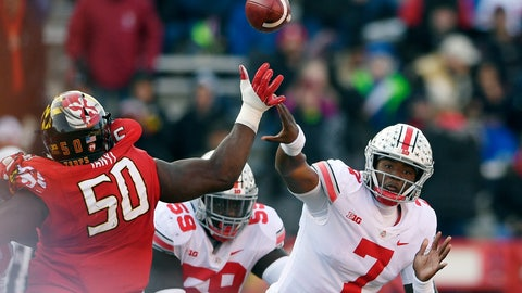 <p>               FILE - In this Saturday, Nov. 17, 2018, file photo, Ohio State quarterback Dwayne Haskins Jr. (7) passes under pressure from Maryland linebacker Mbi Tanyi (50) during the second half of an NCAA football game in College Park, Md. Haskins is ripping up Big Ten passing records, with 42 touchdown passes and 4,081 yards setting new single-season marks.  (AP Photo/Nick Wass)             </p>