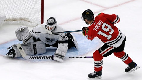<p>               Los Angeles Kings goalie Calvin Petersen, left, blocks a shot by Chicago Blackhawks center Jonathan Toews  (19) in a shootout of an NHL hockey game Friday, Nov. 16, 2018, in Chicago. (AP Photo/Nam Y. Huh)             </p>