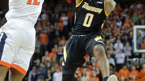 <p>               Towson guard Tobias Howard (0) passes the ball next to Virginia guard De'Andre Hunter (12) during an NCAA basketball game Tuesday, Nov. 6, 2018, in Charlottesville, Va. (AP Photo/Andrew Shurtleff)             </p>