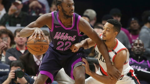 <p>               Minnesota Timberwolves' Andrew Wiggins, left, drives against Portland Trail Blazers' CJ McCollum during the first half of an NBA basketball game Friday, Nov. 16, 2018, in Minneapolis. The Timberwolves players paid tribute to the musician Prince, who died in 2016, with new purple-trimmed uniforms. (AP Photo/Jim Mone)             </p>