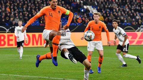 <p>               Netherland's Virgil Van Dijk, left, and Germany's Thomas Mueller challenge for the ball during the UEFA Nations League soccer match between Germany and The Netherlands in Gelsenkirchen, Monday, Nov. 19, 2018. (AP Photo/Martin Meissner)             </p>