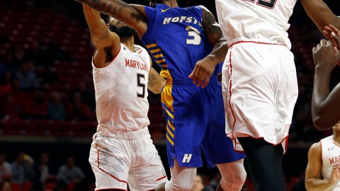 <p>               Hofstra guard Justin Wright-Foreman, center, is fouled by Maryland guard Eric Ayala (5) as he shoots between Ayala and Maryland forward Bruno Fernando, right, of Angola, in the first half of an NCAA college basketball game, Friday, Nov. 16, 2018, in College Park, Md. (AP Photo/Patrick Semansky)             </p>