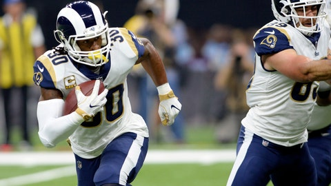 <p>               FILE - In this Sunday, Nov. 4, 2018, file photo, Los Angeles Rams running back Todd Gurley (30) carries for a touchdown in the first half of an NFL football game against the New Orleans Saints in New Orleans. Gurley, last year's Offensive Player of the Year, leads the NFL with 16 touchdowns. the fourth-year pro has scored at least one touchdown in each of the Rams' nine games this season. (AP Photo/Bill Feig)             </p>